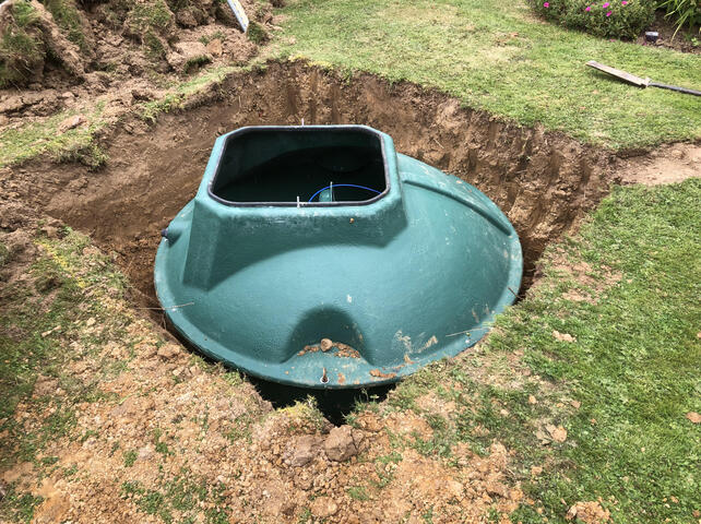 Small sewage treatment plant in the ground with the lid off