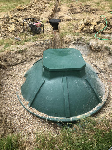 Partially backfilled BioPure sewage treatment system and manhole