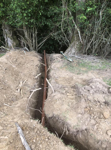 Outlet pipework into ditch with an active stream
