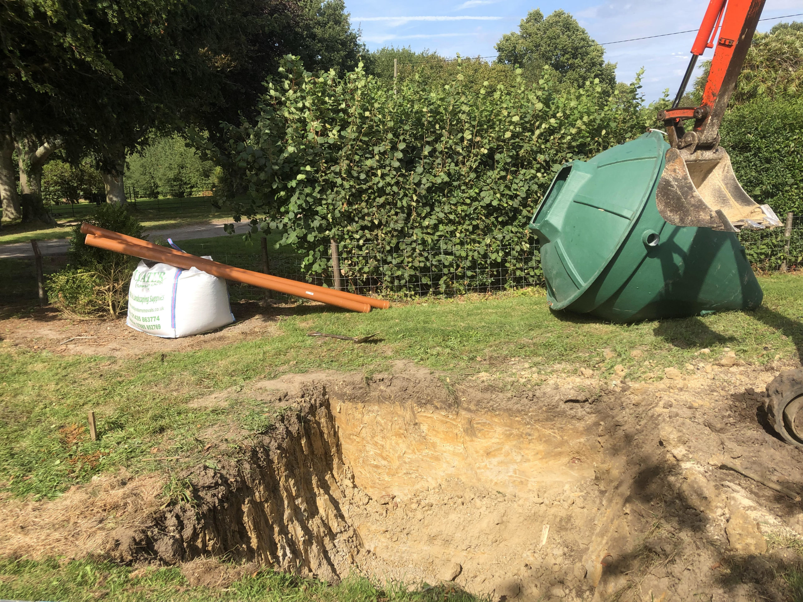 biopure sewage treatment plant installation east sussex next to hole with pipe