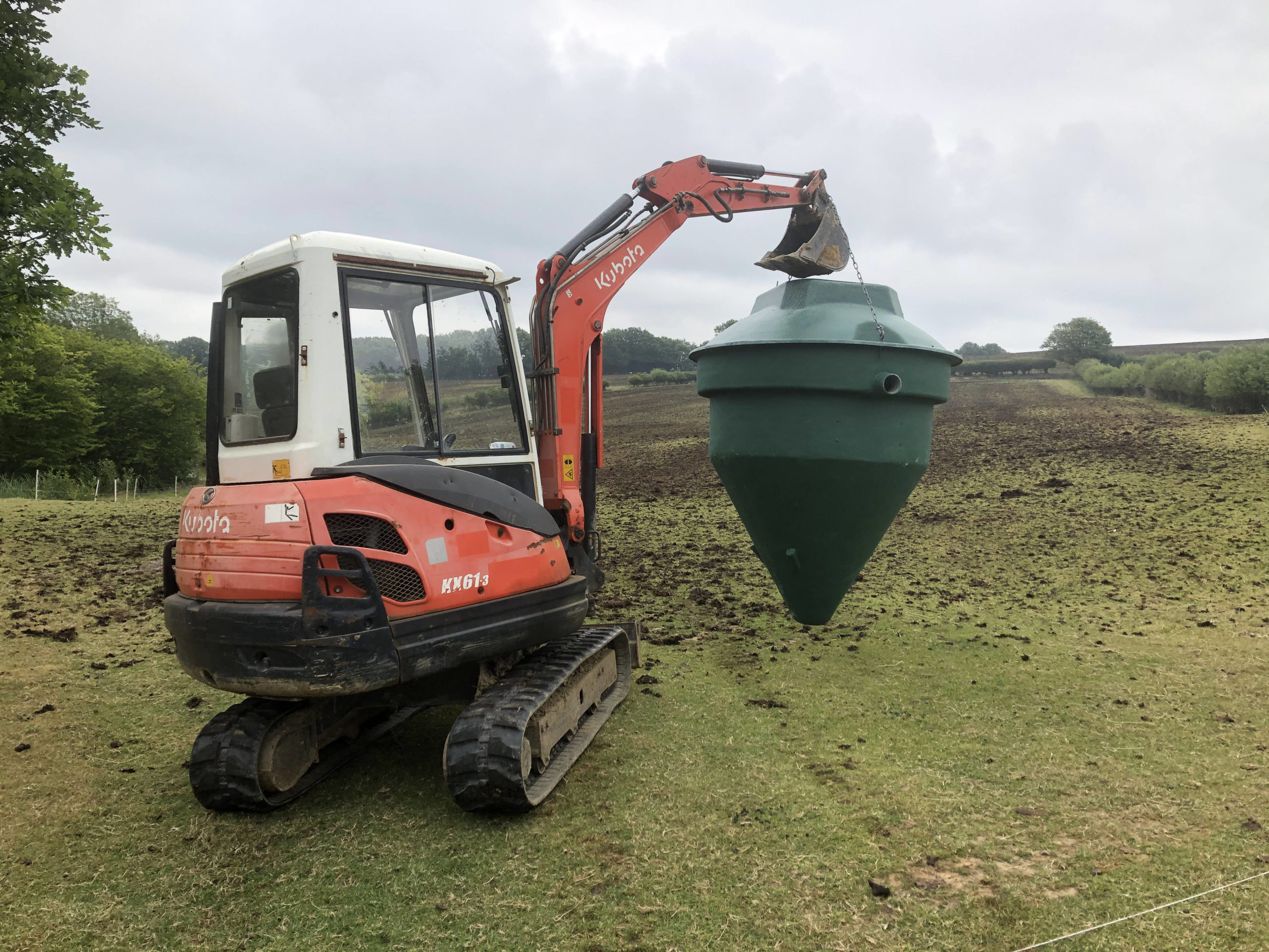 kubota 3t digger carrying a biopure sewage treatment plant east sussex